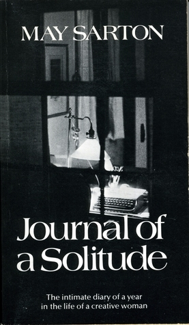 "Black and white cover of May Sarton's ""Journal of a Solitude,"" a shot of an empty desk light by a lamp from outside a window."