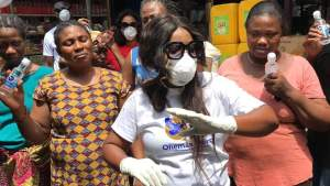 Ohemaa Mercy Gifts Hand Sanitizers To Market Women