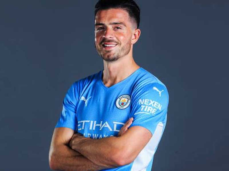 Jack Grealish all smiles as he signs for Manchester City