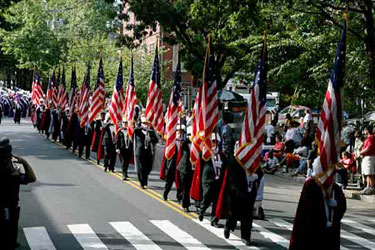 Knights of Columbus of New Haven, Connecticut, present the U.S. flag at the start of New Haven's Columbus Day Parade, 2006. 28 flags demonstrated the history of the U.S. flag. KofC photo