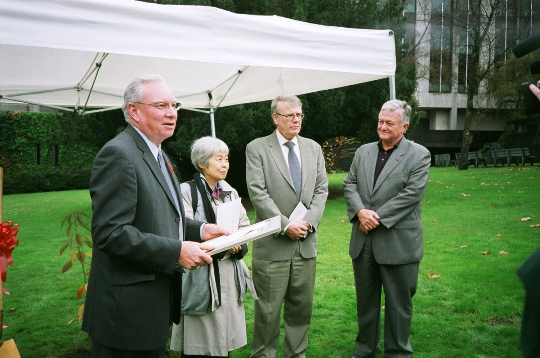 "Vancouver City Hall ""Joy Kogawa Cherry Tree Planting"": Vancouver Mayor Larry Campbell reads proclamation for ""Obasan Cherry Tree Day"", with Joy Kogawa, City Librarian Paul Whitney, and Opera Managing Director James Wright – photo Deb Martin"