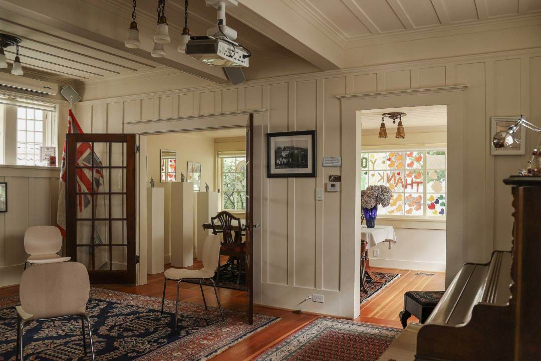 As you come through the doors of the sunroom, you enter the living room which has hosted many events, readings, performances, and important dialogues.