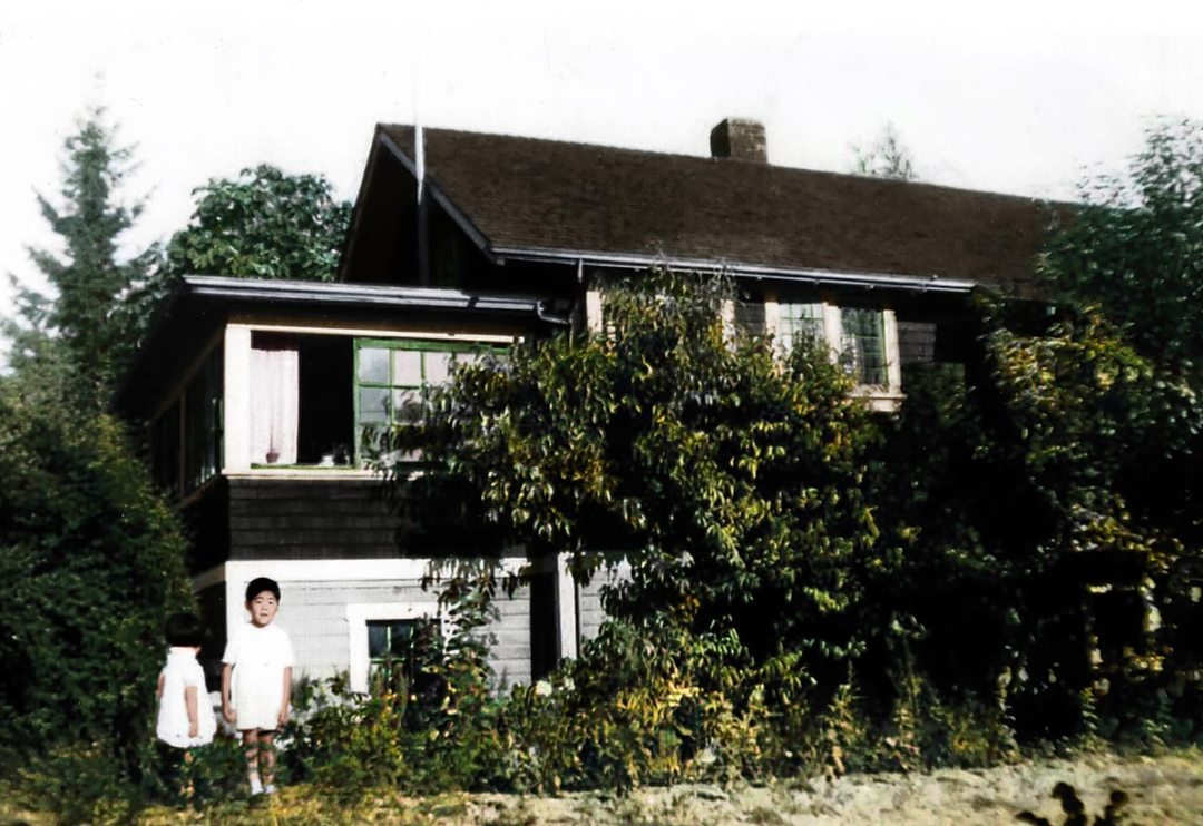 Joy and Tim in front of the house circa 1938