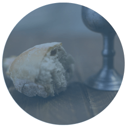 chunk of bread and communion chalice in circle shaped picture