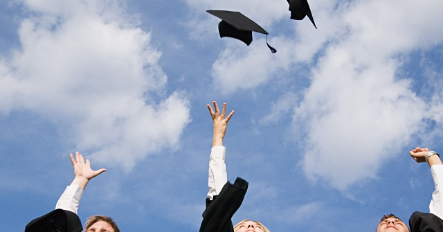 Caps are thrown after a graduation ceremony. (MGN Online)_263989