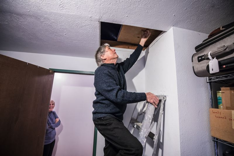 TRIBUNE PHOTO_ JONATHAN HOUSE - Michael Kronenthal accesses his family's attic, where they hope to install new insulation to use less energy. T_551585