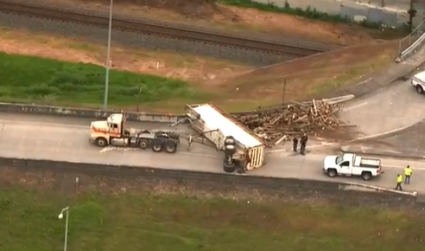 Woods spills from overturned semi-truck on I-84 EB on-ramp