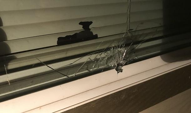Bullet hole in bedroom window 06042019_1559696730527.jpg.jpg