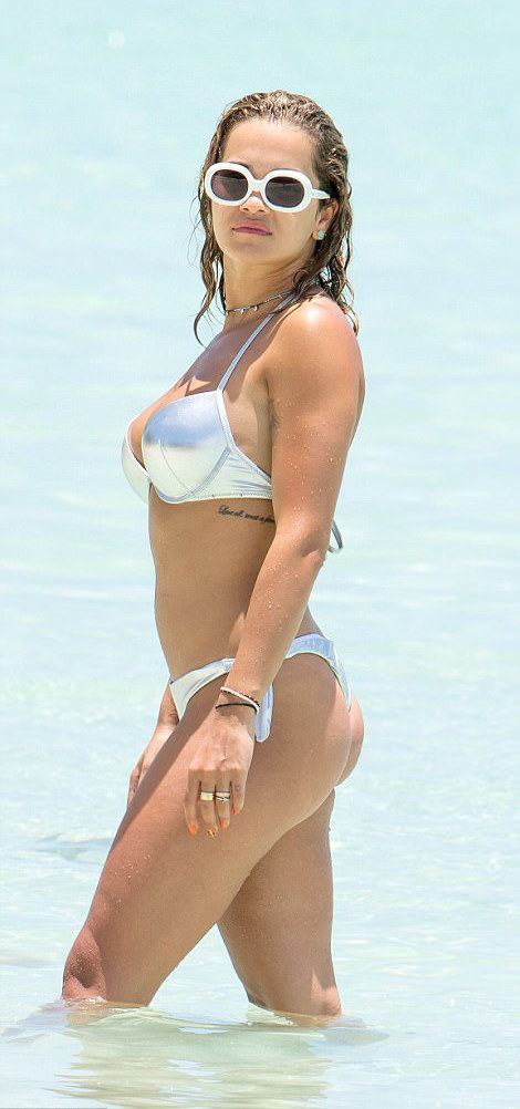 Sun, Sea & Swimwear: Rita Ora Rocks Metallic Tezenis ...
