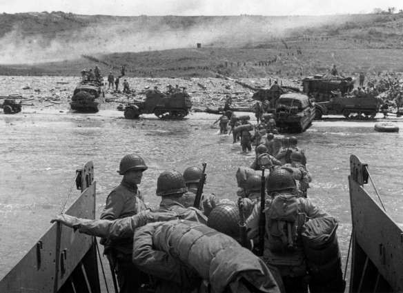 Going ashore into the barrage of enemy gunfire.