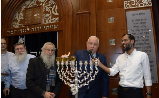 President Reuven Rivlin lights candles in Bet El yeshiva