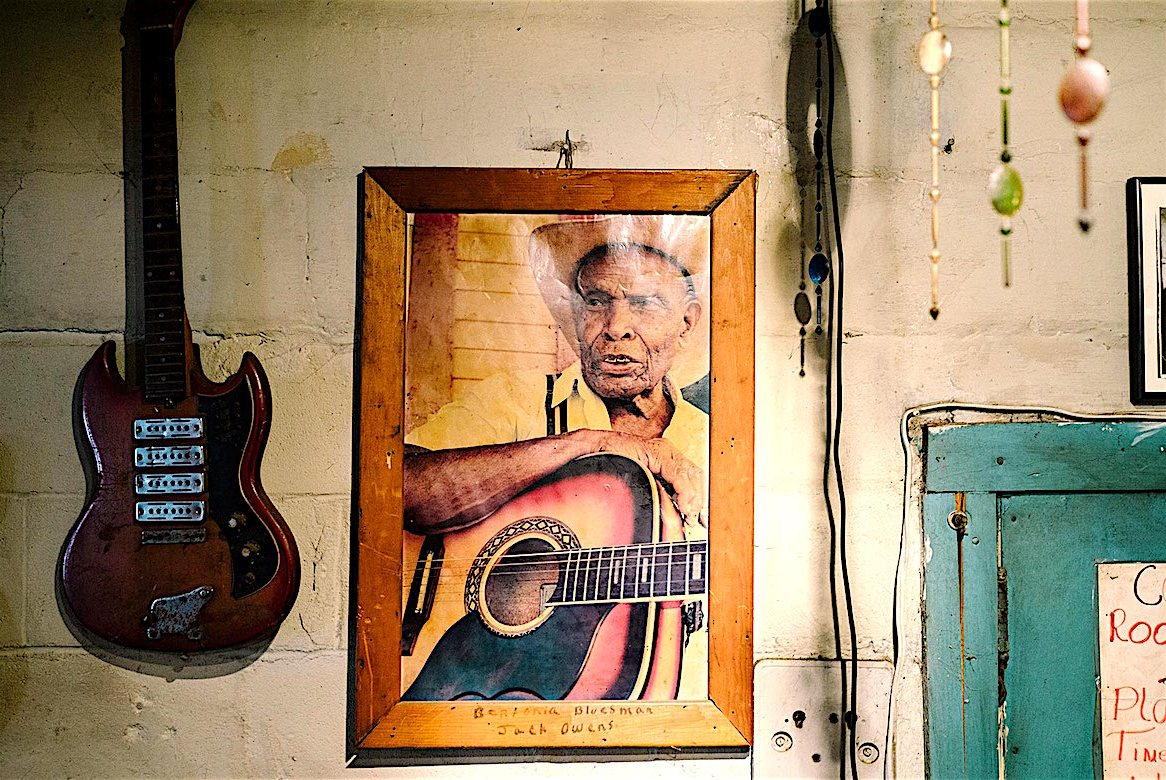 "Bentonia, MS - 3/11/2015 - A photograph of Jack Owens, a legendary blues musician from Bentonia who established a specific style of guitar playing now referred to as ""Bentonia Style"", hangs in the Blue Front Cafe. The Blue Front Cafe opened in 1948 under the ownership of Carey and Mary Holmes, an African American couple from Bentonia. In its heyday the Blue Front was famed for its buffalo fish, blues, and moonshine whiskey. Jimmy ""Duck"" holmes took over the cafe from his parents in 1970 and has continued to operate it as an informal, down-home blues venue that has gained international fame among blues enthusiasts."