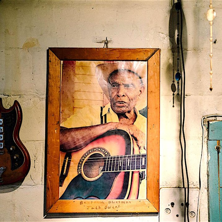 """Bentonia, MS - 3/11/2015 - A photograph of Jack Owens, a legendary blues musician from Bentonia who established a specific style of guitar playing now referred to as """"Bentonia Style"""", hangs in the Blue Front Cafe. The Blue Front Cafe opened in 1948 under the ownership of Carey and Mary Holmes, an African American couple from Bentonia. In its heyday the Blue Front was famed for its buffalo fish, blues, and moonshine whiskey. Jimmy """"Duck"""" holmes took over the cafe from his parents in 1970 and has continued to operate it as an informal, down-home blues venue that has gained international fame among blues enthusiasts."""