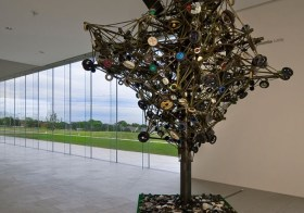 Nari Ward, Land, 2002-present Metal, wood, parachute materials, barrier cloth, used wheels, and audio elements. Installation view: Nerman Museum of Contemporary Art, Overland Park, Kansas. Image courtesy the artist and Lehmann Maupin, New York, and Hong Kong.