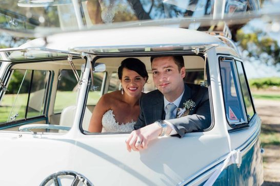 Bride & Groom in front seat of 1960s Vintage Blue Volkswagen Kombi Van on their Wedding Day