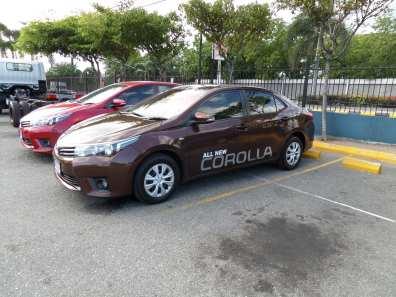 2015 Toyota Corolla Xli (Brown) sedan. Camera: Samsung WB30F.