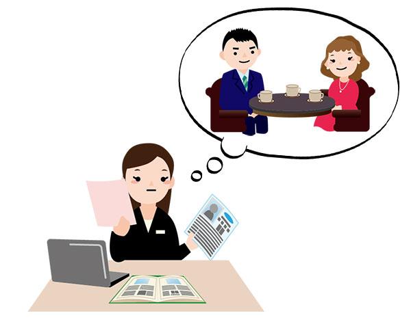 結婚相談所のアドバイザーがカップルを選考している風景