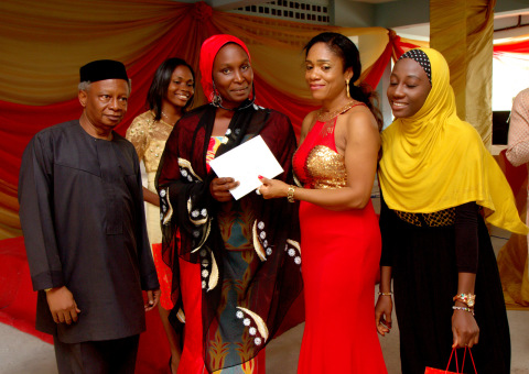 Mrs. Aisha Umar, the subject of the third prize essay receives her prize.