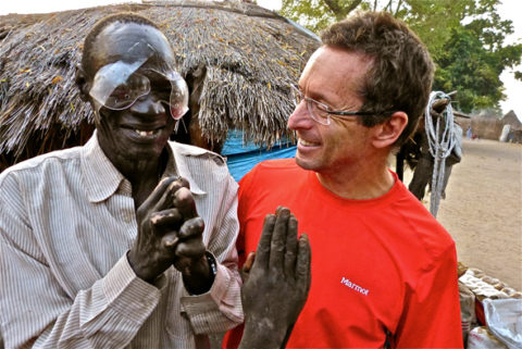"Dr. Tabin celebrates with once ""Blind Leper"" in Duk Payuel; Photograph by Jordan Campbell Source: adventureblog.nationalgeographic.com"