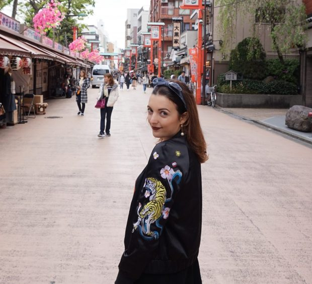Jasmine walking down a street in Asakusa