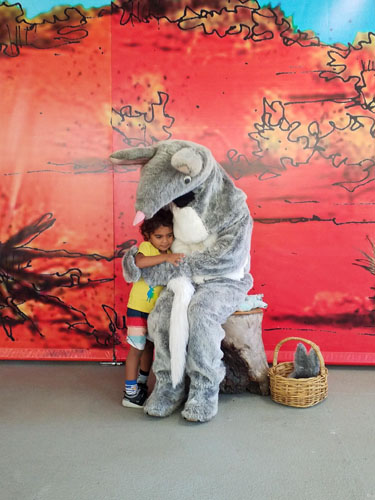 Photo of Koobara child hugging a bilby at Bunyaville Environmental Education Centre