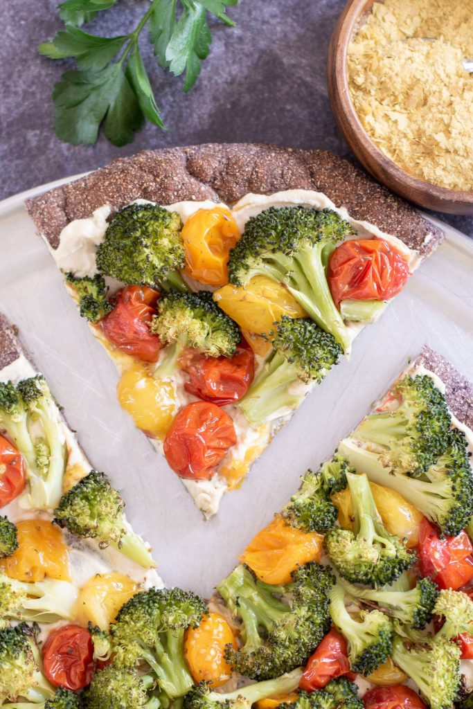 RUSTIC LOW CARB PIZZA CRUST with Vegan Cheese, Tomatoes, and Broccoli