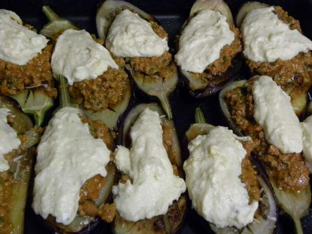 Papoutsakia (stuffed eggplants) with meat sauce and bechamel