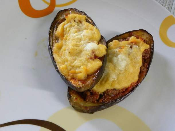 Papoutsakia (stuffed eggplants) with semolina bechamel