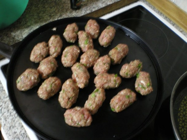 Shaping meatballs keftedes image