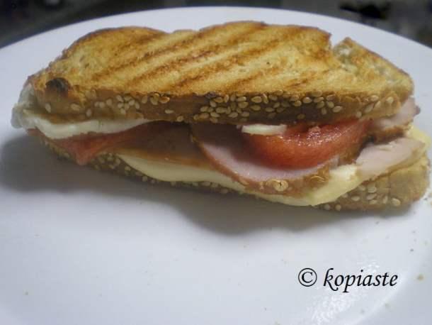 Sandwich with lountza and halloumi
