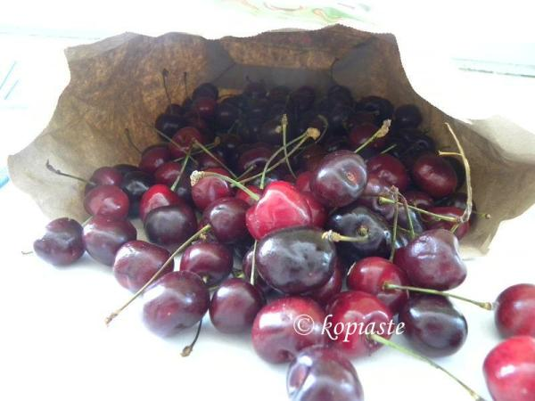 Cherries in a paper bag image