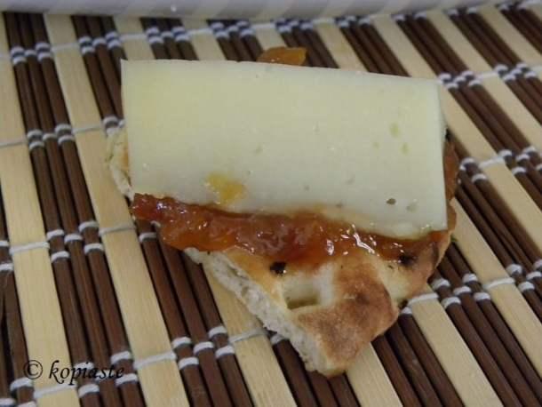 Pita chips with jam and graviera