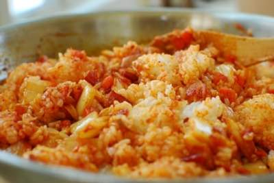 stir frying rice with kimchi and bacon
