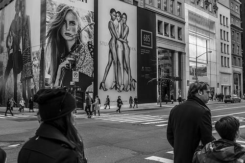 city advertising black and white photo