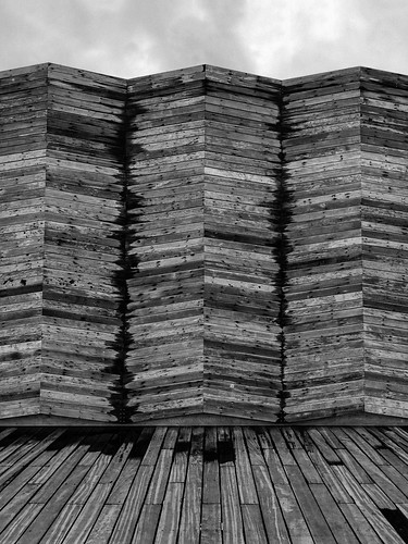article about consumerism - black and white wood pallets