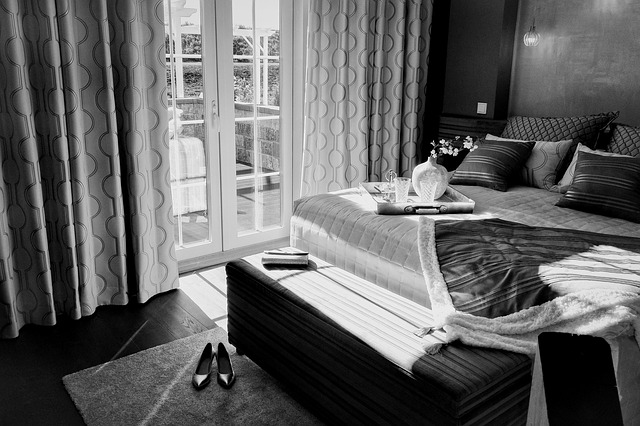 article about money making you happy - black and white luxury hotel room