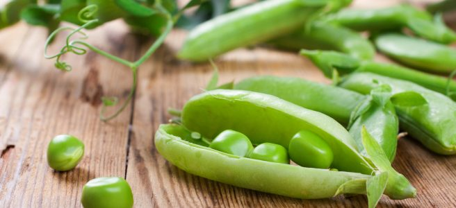 split open fresh green peas