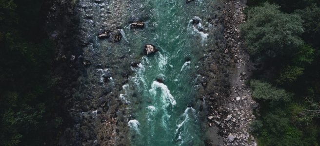 fast flowing river from bird's eye view