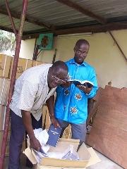 Kouya New Testaments arrive in Abidjan