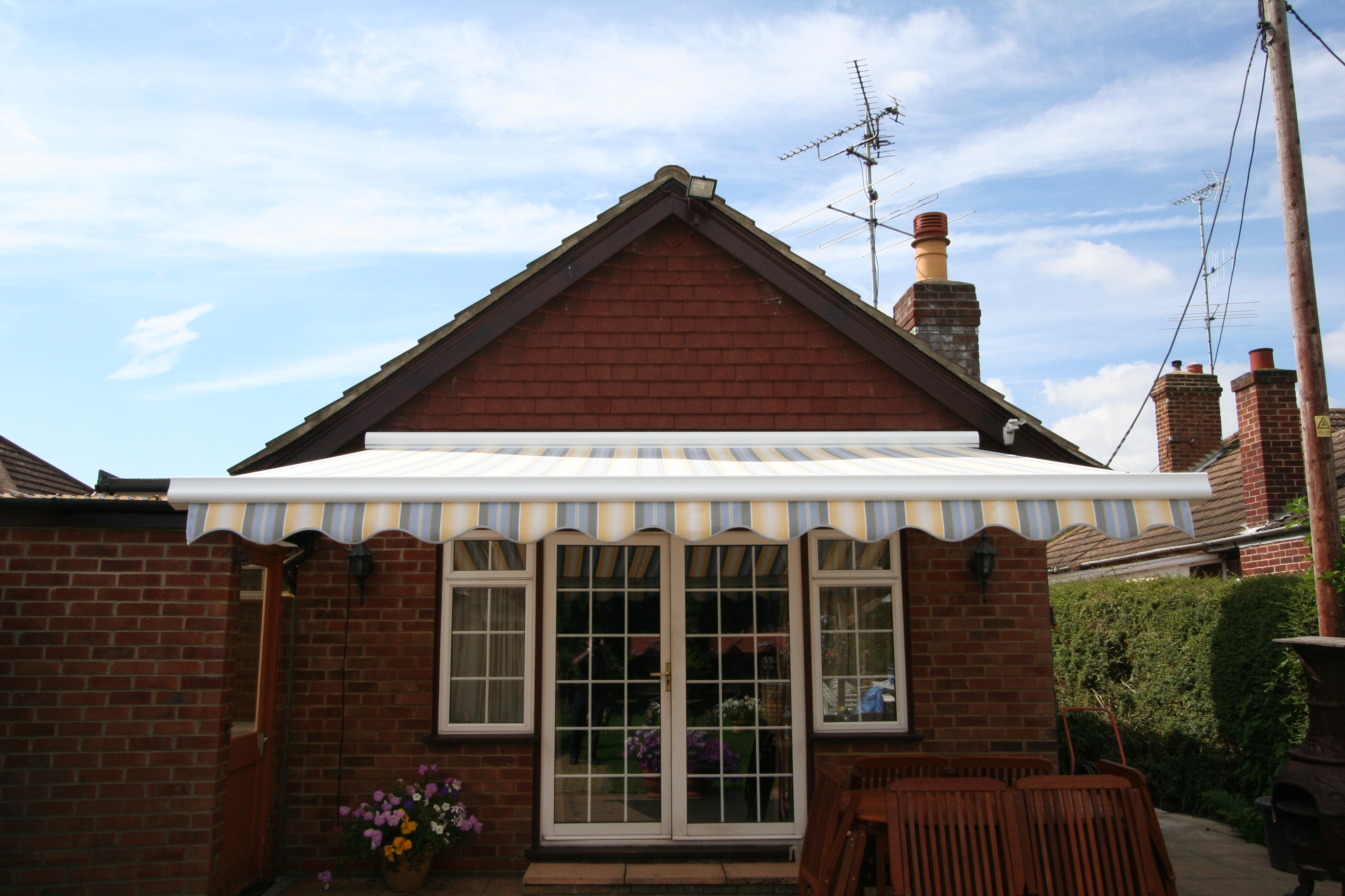 Patio Awning Installed To Tiled Face Property