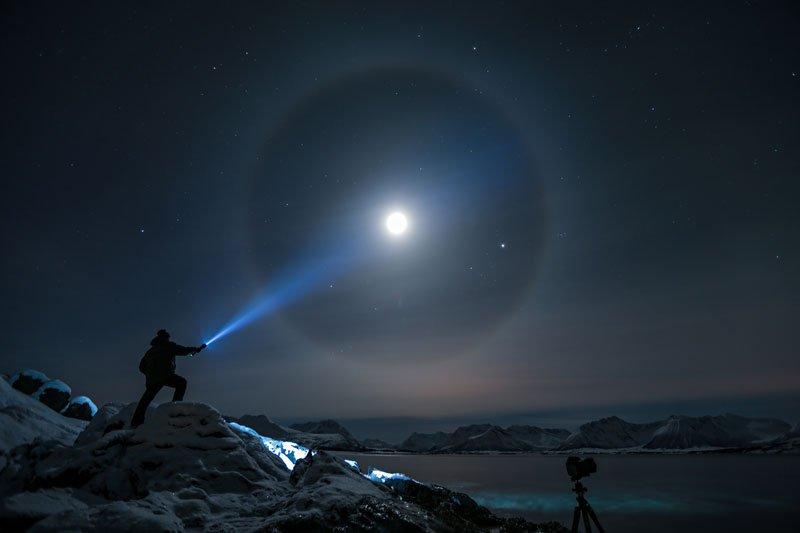 shining-flashlight-onto-moon-at-night