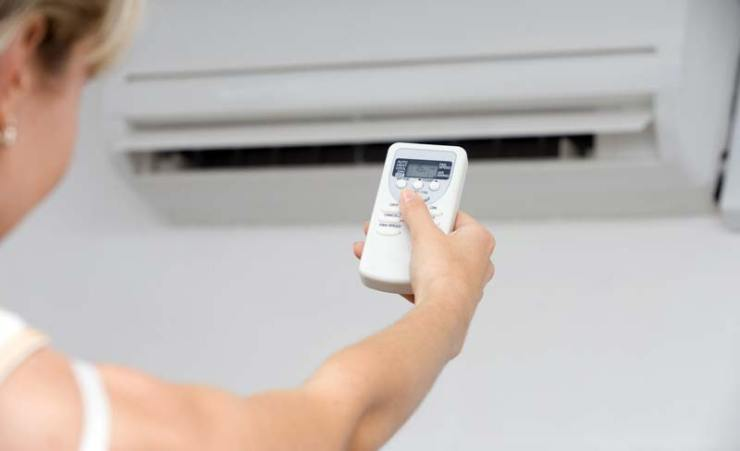 bigstock-Hand-of-woman-includes-air-con-12558755