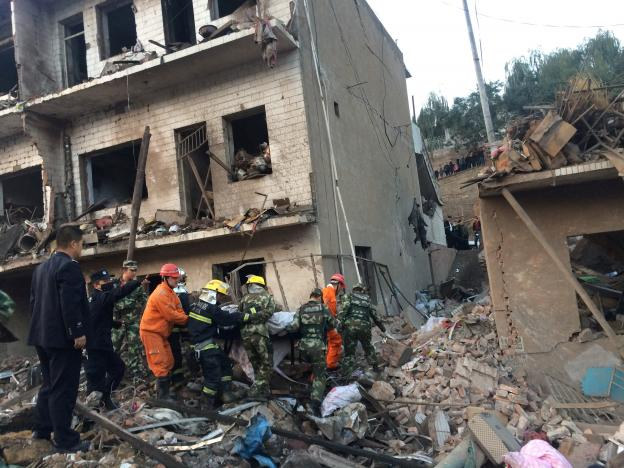 Rescue workers search at site after an explosion hit a town in Fugu county, Shaanxi province, China, October 24, 2016. China Daily/via REUTERS