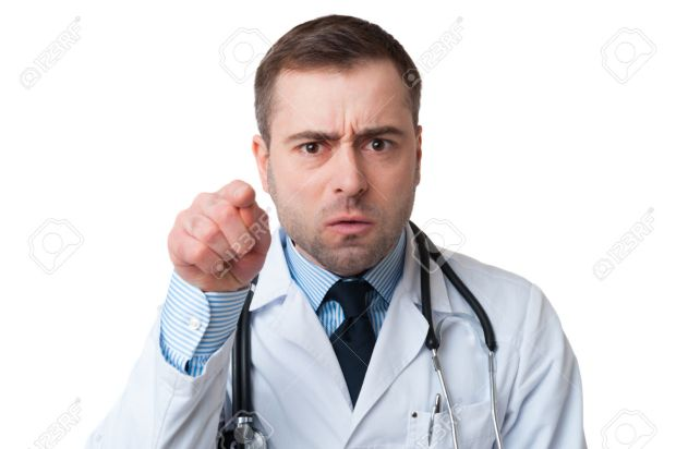 Angry male doctor pointing finger at you with stethoscope around his neck, pointing at camera with serious face isolated on white background