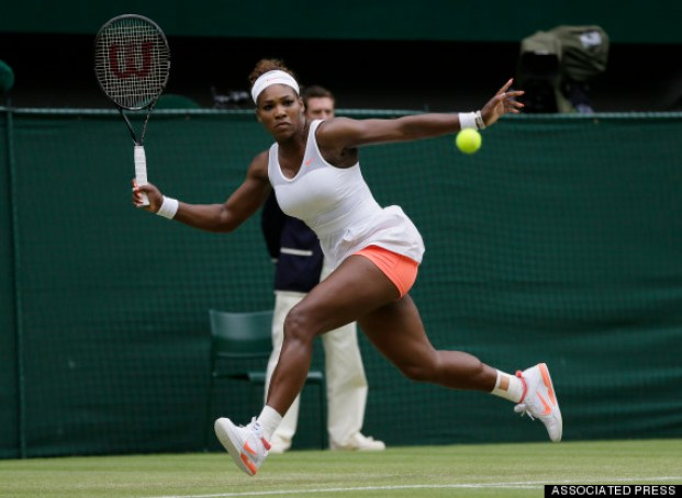 Serena Williams of the United States returns to Sabine Lisicki of Germany during a Women's singles match at the All England Lawn Tennis Championships in Wimbledon, London, Monday, July 1, 2013. (AP Photo/Alastair Grant)