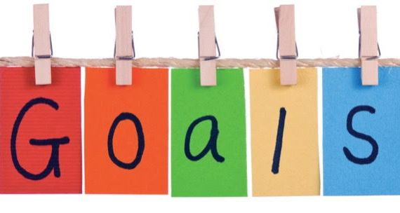 """Colorful flags spelling out """"Goals"""""""
