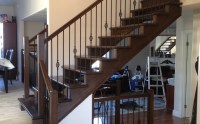 Custom open riser staircase with birdcage wrought iron ...