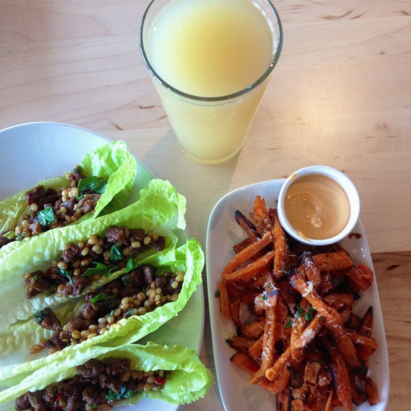 LYFE Kitchen spicy korean lettuce wraps, garlic parmesean sweet potato fries, and a ginger beer