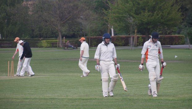 Trudge ... Jack walks back to the boundary accompanied by Will