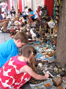 This is a sincere photo--no posing.  The kids really get into the antique--or rather dirt market--part of this spot.  Once we get to the wares displayed on the ground, they hit their haunches and take a good look at what there is.